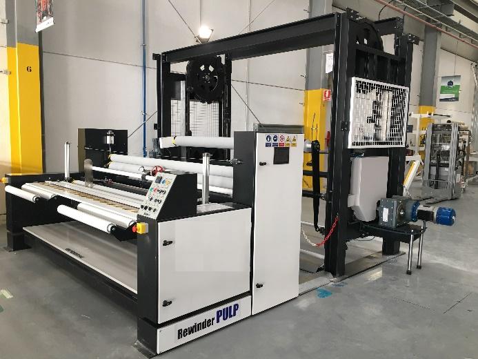 automatizacion de maquinaria en barcelona atelma maquina de enrolla con noria porta tejidos